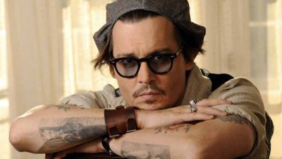 Whose name did Johnny Depp have tattooed on his arm in 1990?