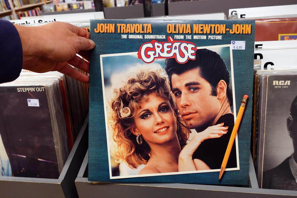 Did John Travolta sing in Grease?
