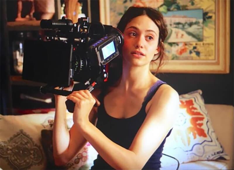 emmy rossum holding a camera