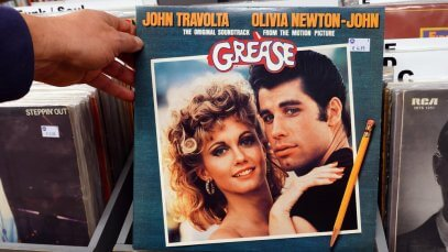 Did John Travolta sing in Grease?